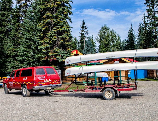 transporting canoes & kayaks, Becker's Lodge, Bowron Lake, BC