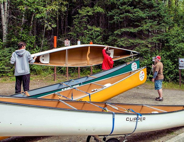 Preparing canoes for departure